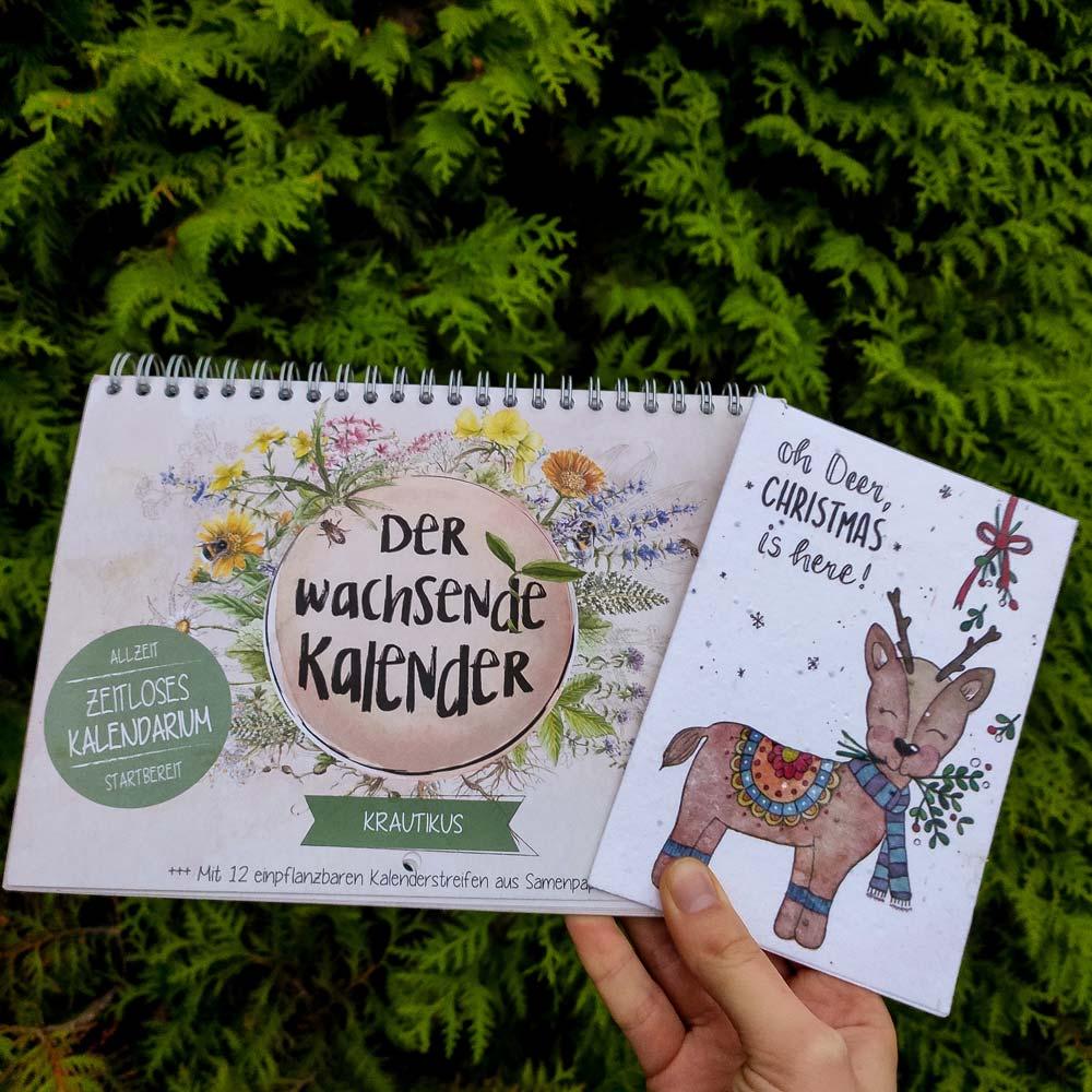 """Der wachsende Kalender """"Krautikus"""" und Saatgut Weihnachtskarte mit Rentierillustration."""